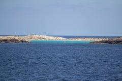 Beach Ses Illetas, Formentera,   Spain. View of ses Illetas beach in Formentera from open sea,  Balearic Islands, Spain Royalty Free Stock Image