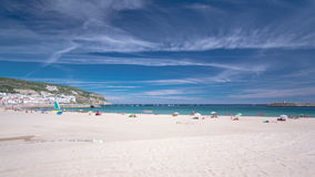 Beach in Sesimbra with moving clouds, Portugal stock video