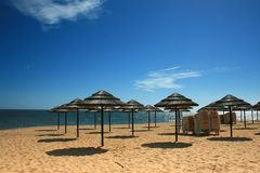 Beach Shade. Straw beach parasols against a blue sky royalty free stock photo