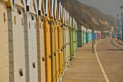 Beach sheds. Bournemouth beach holiday homes on the coast south england, colourful small beach sheds in a row Stock Photography