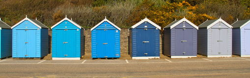 Beach sheds. Bournemouth beach holiday homes on the coast south england, colourful small beach sheds in a row Stock Photos