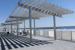 Beach shelters on the sea coast Royalty Free Stock Images