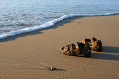 Beach Shoes. Sandals on a beach, photographed in early morning sunlight Stock Photography