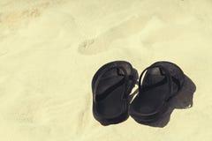 Beach shoes sandals flip-flops on beach Stock Photography