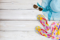 beach shoes with sunglasses and hat on white wood background,Sum Royalty Free Stock Photography