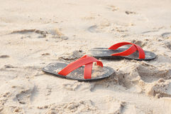 Beach. Shoes on the beach in thailand Royalty Free Stock Images