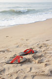 Beach. Shoes on the beach in thailand Royalty Free Stock Photos