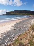 Beach Shore. Orkney Island sea coastline in Scotland with sandy and rocky shore line. Small waves are washing sand beach stock image