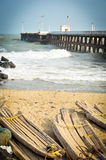 Beach and shore. Pier on the ocean and wooden raft on the beach, Puducherry (India Stock Photography