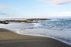 Beach shoreline with gentle surf Royalty Free Stock Images