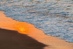 Beach Shoreline Reflections. Beach sand ocean waterline sunrise color reflections of nature Royalty Free Stock Photo