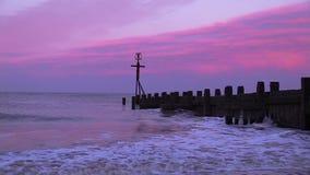 Beach shoreline at sunset. Video of beach shoreline at sunset stock footage