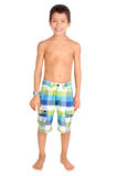 Beach shorts. Little boy with beach shorts isolated in white stock images