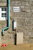 Beach Shower, Weston-Super-Mare. A rather unattractive and basic shower available to holidaymakers at the sandy beach in the traditional seaside resort of Weston Stock Images