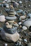 Beach Shrine. Carefully balanced rocks on a beach Royalty Free Stock Photos