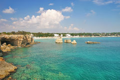 Beach in Sicily. View of the beach of Fontane Bianche, near Syracuse - Sicily, famous for its transparent water, golden sand and touristic resorts royalty free stock photo