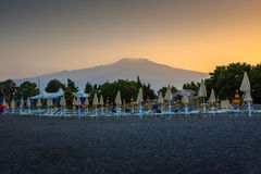 The beach in Sicily with views of Mount Etna. Royalty Free Stock Photography