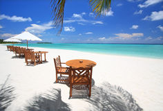Beach side. Table and chairs on exotic beach Stock Photography