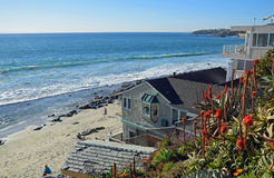 Beach side home overlooking Cleo Street Beach in Laguna Beach, California. Image shows a beach side home overlooking Cleo Street Beach just south of the Main stock images