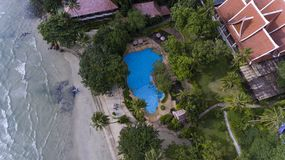 Beach side resort surrounded by green trees and blue water. Koh Chang, Thailand royalty free stock image