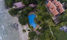 Beach side resort surrounded by green trees and blue water. Koh Chang, Thailand royalty free stock photo
