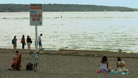 Beach sign and girl about to leave stock video footage
