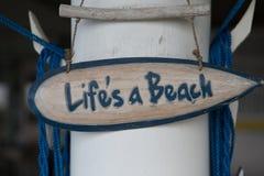 Beach sign Life is a Beach Stock Photo