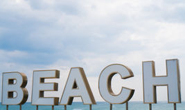 `Beach` sign over sea and sky Stock Images