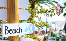 Free Beach Sign Pointing At Beach Royalty Free Stock Photo - 56083865