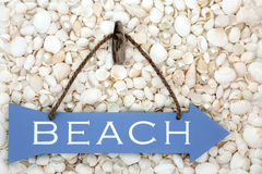 Beach Sign on Seashells and Pearls Royalty Free Stock Photo