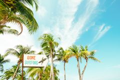 Beach sign for surfing area. Landscape of coconut palm tree on tropical beach in summer. beach sign for surfing area. Vintage effect color filter royalty free stock photo