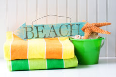 Beach sign and towels Stock Photo