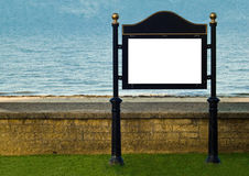 Beach Signpost. An image of a signpost situated against a wall at a sunny beach royalty free stock photos
