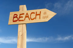 Beach signpost. Wooden signpost indicating Beach direction over blue sky royalty free stock images