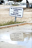 Beach signs in Greek & English Royalty Free Stock Images