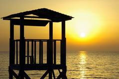 Beach Silhouette. Beach sunset with silhouette watch tower Stock Photo