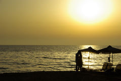 Beach Silhouette. Beach sunset with silhouette couple Stock Photography