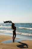 Beach Silhouette. Beautiful young female in bikini posing at the beach stock images