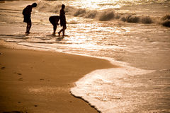 Beach with Silhouette people Royalty Free Stock Photography