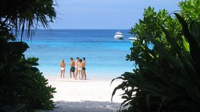 Beach at Similan Islands, Thailand. Tourists on the beach at Similan Islands, Thailand Royalty Free Stock Image