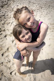 Beach sisters love Stock Photography