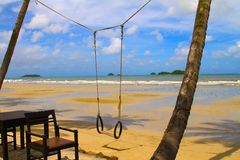 Beach. Sitting and Swing on the Beach Royalty Free Stock Photography