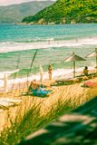 Summer day at the beach. Beach in Skiathos Island, Greece, September 2018 Vintae shot with people swimming and sunbathing stock image
