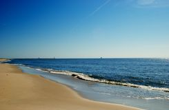 Beach and sky. Cape May New Jersey, Ferry Beach along the Bay Stock Images