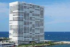 The Beach Skyscraper. The tall white skyscraper built straight on a beach in Fort Lauderdale, Florida stock photography