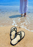 Beach slippers on beach sand Royalty Free Stock Photo