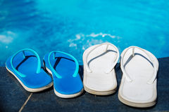 Beach slippers on border of swimming pool stock image