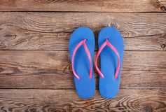 Beach slippers on the old board Stock Images