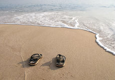 Beach slippers in the sand on beach stock images