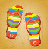 Beach slippers on sand. Royalty Free Stock Images